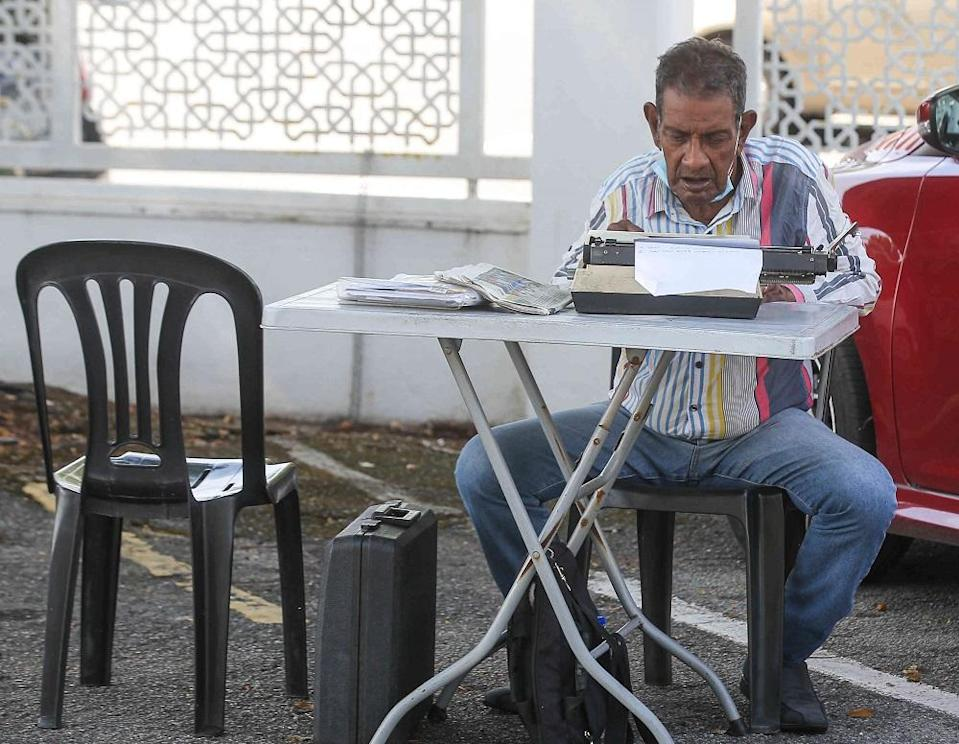 Septogenarian Ezekiel Velu is one of the surviving petition writers in Ipoh who steadfastly ensures the trade continues. — Picture by Farhan Najib