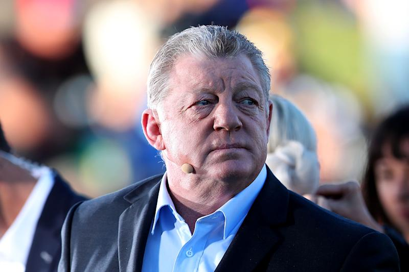 Commentator Phil Gould waiting to speak during broadcast.