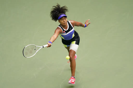 Naomi Osaka, of Japan, returns a shot to Victoria Azarenka, of Belarus, during the women's singles final of the US Open tennis championships, Saturday, Sept. 12, 2020, in New York. (AP Photo/Frank Franklin II)