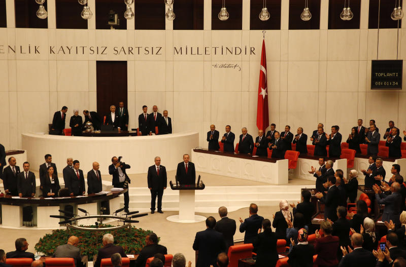 Turkey's President Recep Tayyip Erdogan is applauded by lawmakers at the parliament in Ankara, Turkey, Monday, July 9, 2018 when taking the oath of office for his second term as president. (AP Photo/Lefteris Pitarakis)
