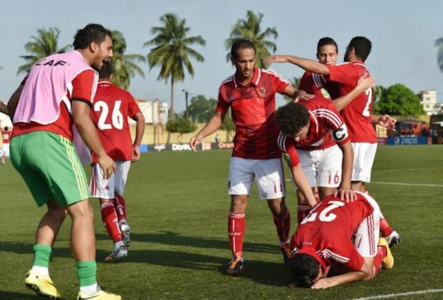 Egyptian's Al-Ahly players celebrate scoring a goal during a Confederation Cup match in Abidjan, in November 2014