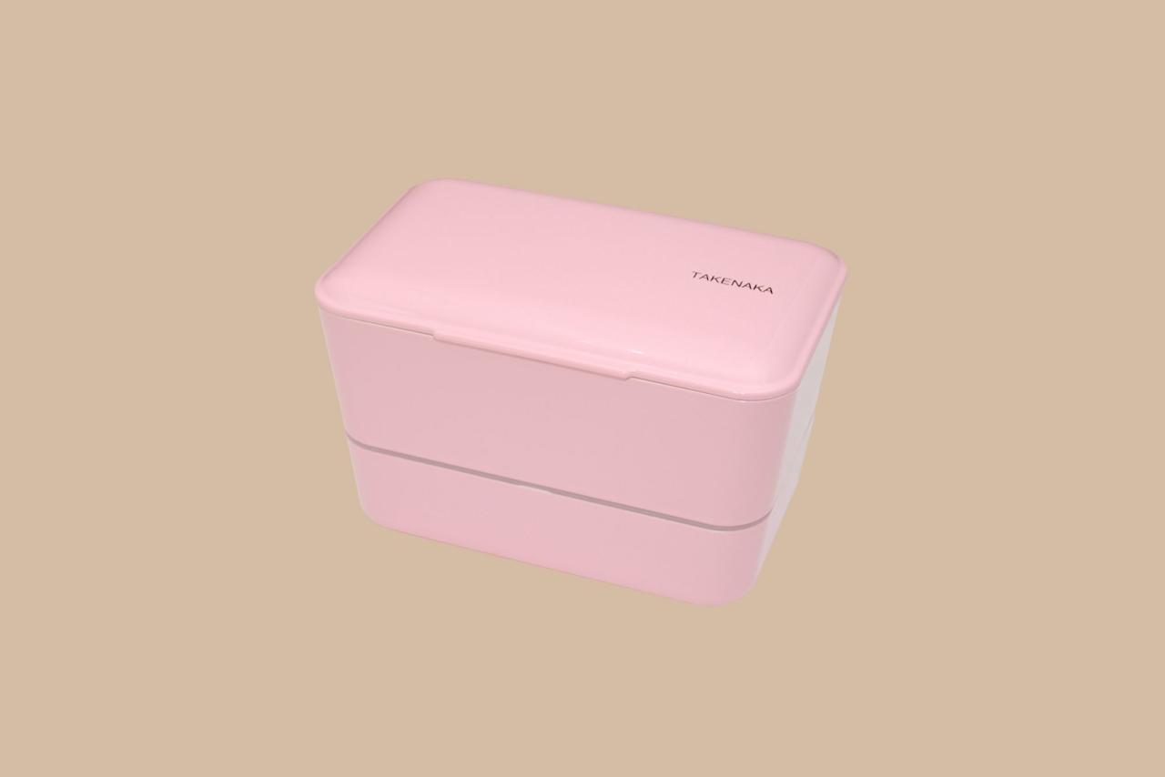 """<p>Available in a variety of eye-catching, candy-colored hues, all of your colleagues will ask where you got this bento box. Made in Japan from durable plastic, this option is microwave and dishwasher safe.</p> <p><strong><em>Shop Now:</em></strong><em> Takenaka Bento Box, $38, </em><a href=""""https://www.williams-sonoma.com/products/takenaka-bento-box/?clickid=UDm1NZ3xWxyJTnixTV1LXQupUknRv%3Ax7hSKkSA0&amp;irgwc=1&amp;cm_cat=249354&amp;cm_ven=afshoppromo&amp;bnrid=3917500&amp;cm_ite=&amp;cm_pla=ir&amp;irpid=249354""""><em>williams-sonoma.com</em></a><em>.</em></p>"""