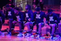 The Georgetown basketball team takes a knee during the national anthem before an NCAA college basketball game against Butler, Wednesday, Jan. 6, 2021, in Indianapolis. (AP Photo/Darron Cummings)