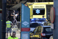 <p>Armed policemen arrive in a cordoned off area after a van ploughed into the crowd, injuring several persons on the Rambla in Barcelona on August 17, 2017. (Josep Lago/AFP/Getty Images) </p>