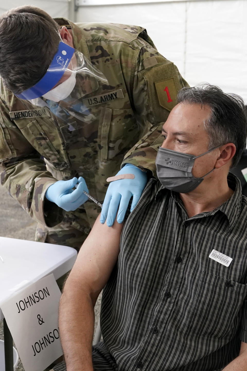 Armelio Acosta receives the Johnson & Johnson COVID-19 vaccine at a FEMA mass vaccination center at Miami Dade College, Wednesday, March 3, 2021, in North Miami, Fla. This is one of four FEMA sites in Florida that opened Wednesday with capacity to vaccinate up to 3,000 people a day seven days a week. (AP Photo/Marta Lavandier)