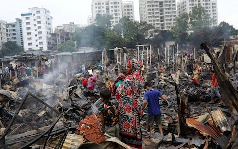 Up to 50,000 people could be rendered homeless by the blaze - Credit: REUTERS/Mohammad Ponir Hossain