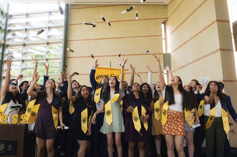 In this March 13, 2020, photo, senior residents of Rice's Wiess College perform a mock commencement ceremony at the school in Houston. Due to the coronavirus outbreak it's not clear whether the campus will reopen in time for graduation. The new coronavirus causes mild or moderate symptoms for most people, but for some, especially older adults and people with existing health problems, it can cause more severe illness or death. (Jeff Fitlow/Rice University via AP)