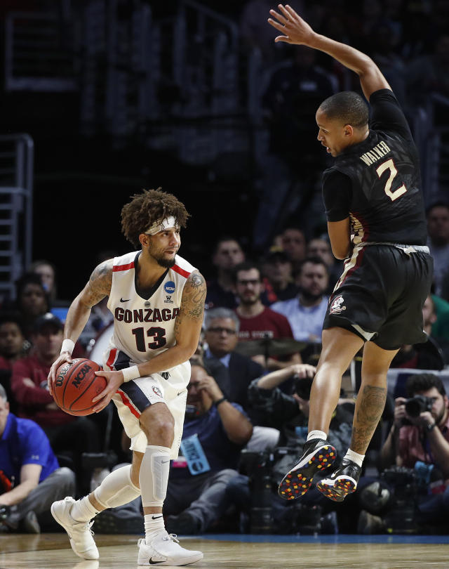 Gonzaga guard Josh Perkins (13) is defended by Florida State guard CJ Walker (2) during the first half of an NCAA men's college basketball tournament regional semifinal Thursday, March 22, 2018, in Los Angeles. (AP Photo/Jae Hong)