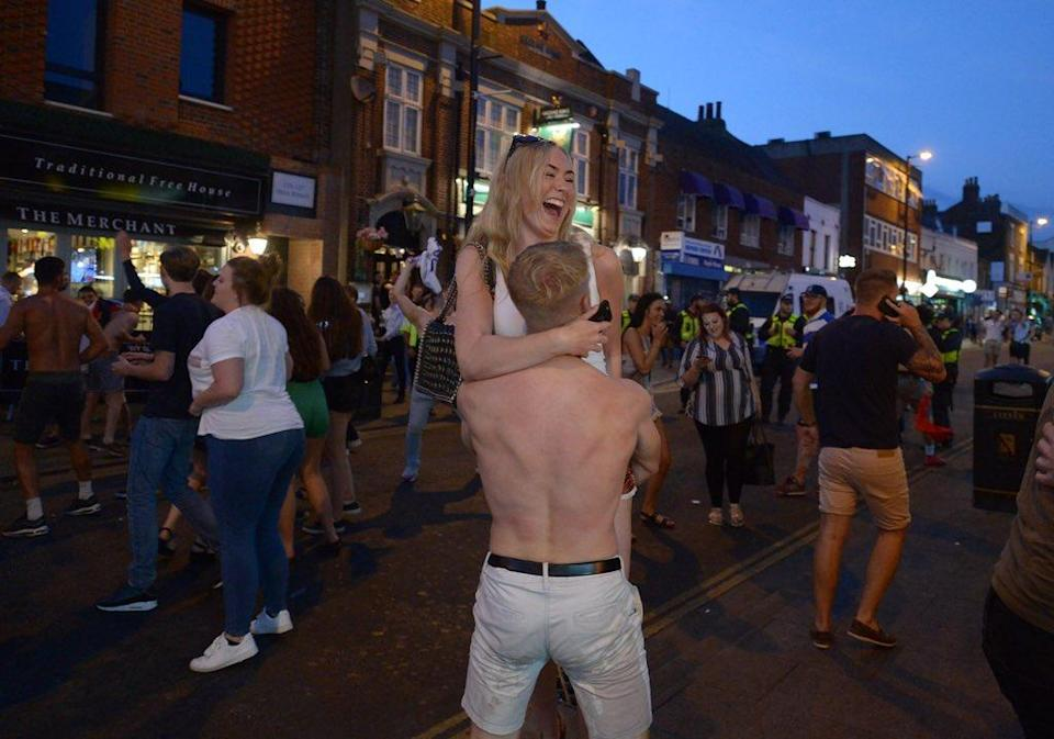 England fans in Brentwood celebrate wildly at the final whistle