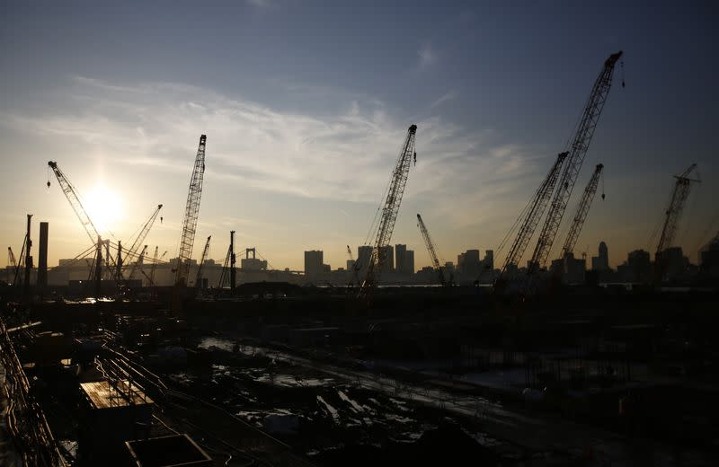 Cranes are pictured at a construction site at the coastal area of Tokyo Bay in Tokyo