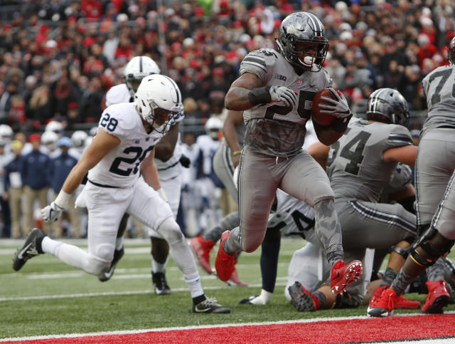 Ohio State running back Mike Weber (R) scores a touchdown against Penn State during the first half of an NCAA college football game Saturday, Oct. 28, 2017, in Columbus, Ohio. (AP Photo/Jay LaPrete)
