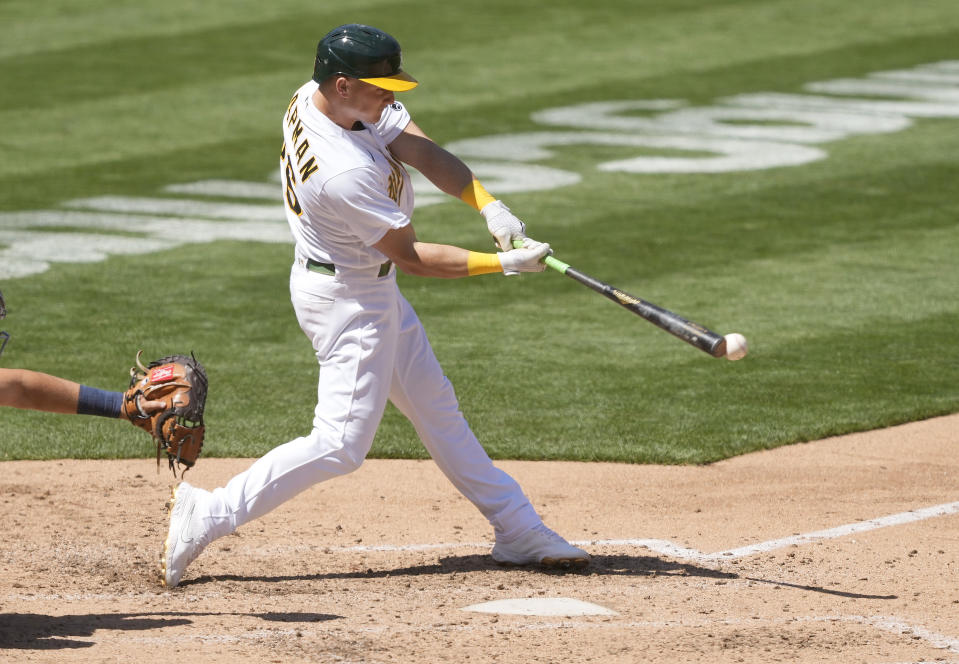 Oakland Athletics' Matt Chapman (26) hits a single to drive in a run against the Detroit Tigers during the fifth inning of a baseball game on Saturday, April 17, 2021, in Oakland, Calif. (AP Photo/Tony Avelar)