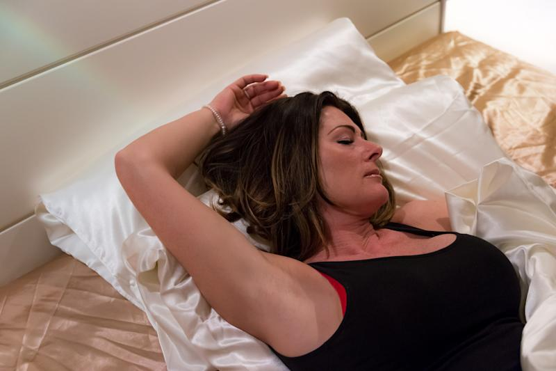 Woman is sleeping in the bed