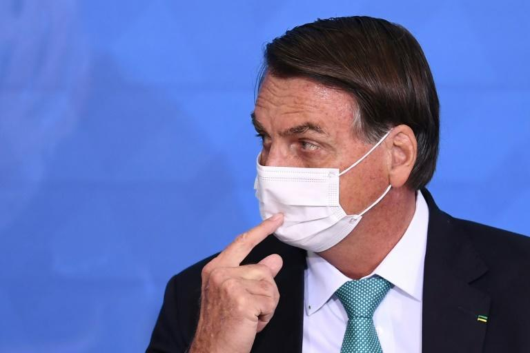 Brazilian President Jair Bolsonaro, pictured June 21, 2021, is facing a growing scandal over a questionable vaccine order