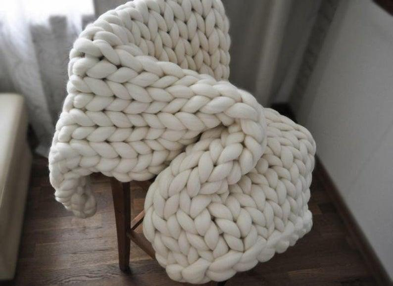 "<h2>MadiMStore Chunky Wool Knit Throw Blanket</h2><br>You can't go wrong with a handmade, chunky knitted merino wool throw in an oversized silhouette. <br><br><strong>Comfort Critics Say:</strong> ""Very lovely, soft, and cozy. It's a hit with my daughter, too. Will hopefully stay with her until college and beyond. Thank you!"" - <em>Jenn S. </em><br><br><strong><em><a href=""https://fave.co/3mGIVcN"" rel=""nofollow noopener"" target=""_blank"" data-ylk=""slk:Shop Etsy"" class=""link rapid-noclick-resp"">Shop Etsy</a></em></strong><br><br><strong>MadiMStore</strong> Chunky Knit Throw Blanket, $, available at <a href=""https://go.skimresources.com/?id=30283X879131&url=https%3A%2F%2Ffave.co%2F37DmRvm"" rel=""nofollow noopener"" target=""_blank"" data-ylk=""slk:Etsy"" class=""link rapid-noclick-resp"">Etsy</a>"