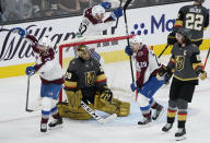 Colorado Avalanche right wing Joonas Donskoi, left, and center Nathan MacKinnon (29) celebrate after teammate Mikko Rantanen, not pictured, scored a goal against Vegas Golden Knights goaltender Marc-Andre Fleury (29) during the second period in Game 6 of an NHL hockey Stanley Cup second-round playoff series Thursday, June 10, 2021, in Las Vegas. (AP Photo/John Locher)