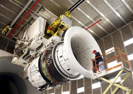 General Electric employee Brian Kirk prepares a GEnx-747 jet engine at the GE Aviation Peebles Test Operations Facility in Peebles, Ohio in this file photo taken November 15, 2013. REUTERS/Matt Sullivan