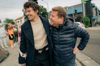 <p>This cozy cable-knit sweater is right up there with the one Chris Evans wore in <strong>Knives Out</strong>. Harry paired his with a navy blue peacoat and his million-dollar smile, of course.</p>