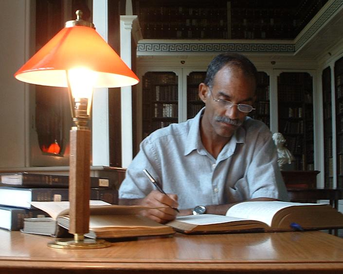 Tony Burroughs researches his ancestors in a library at the University of Oxford, England.