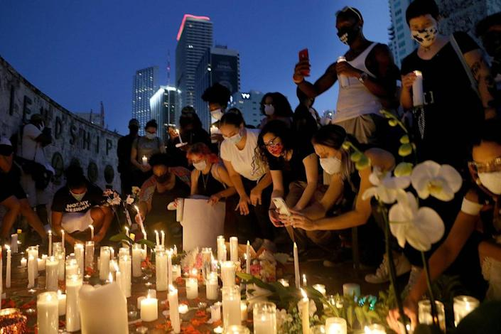 """A group of activists and residents attended a vigil at the Friendship Torch in downtown Miami on Tuesday, June 16, 2020, for Black Lives Matter activist Oluwatoyin """"Toyin"""" Salau whose body was found in Tallahassee on Saturday, the Tallahassee Police Department confirmed."""