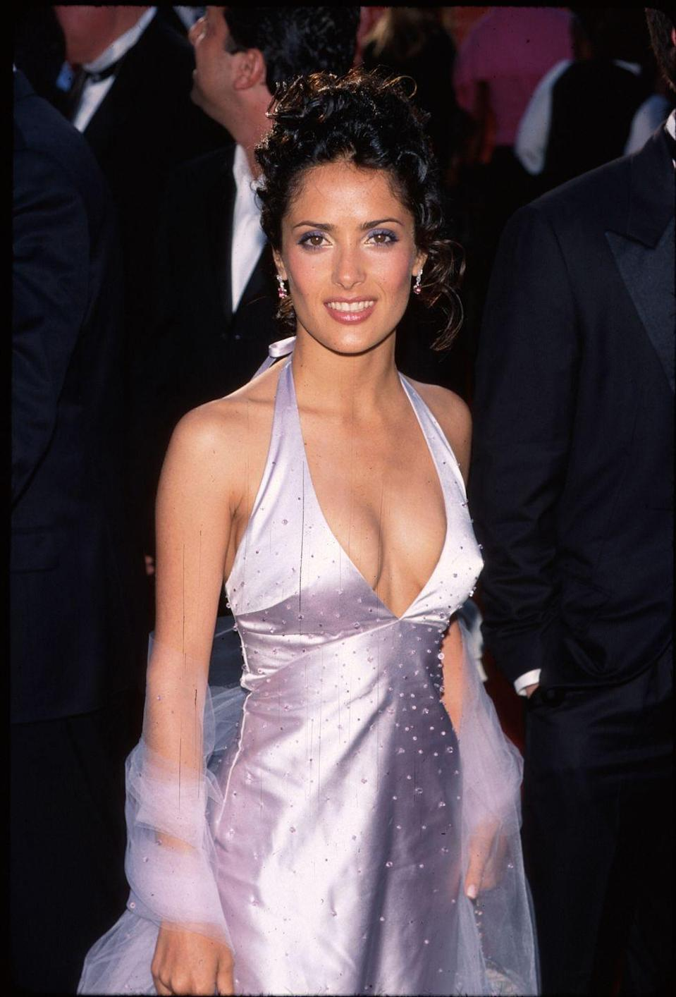<p>Salma brought early-aughts glam to the ceremony in a plunging lilac halter dress and matching shawl. She presented the Academy Award for Technical Achievement later that night.</p>