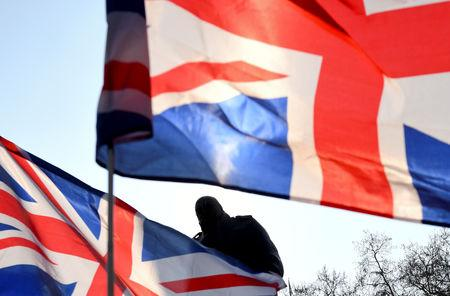 FILE PHOTO: British flags fly near the Winston Churchill statue outside the Houses of Parliament during a pro-Brexit protest in London, Britain, March 29, 2019. REUTERS/Dylan Martinez