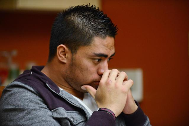 """In a photo provided by ESPN, Notre Dame linebacker Manti Te'o pauses during an interview with ESPN on Friday, Jan. 18, 2013, in Bradenton, Fla. ESPN says Te'o maintains he was never involved in creating the dead girlfriend hoax. He said in the off-camera interview: """"When they hear the facts they'll know. They'll know there is no way I could be a part of this."""" (AP Photo/ESPN Images, Ryan Jones) MANDATORY CREDIT"""