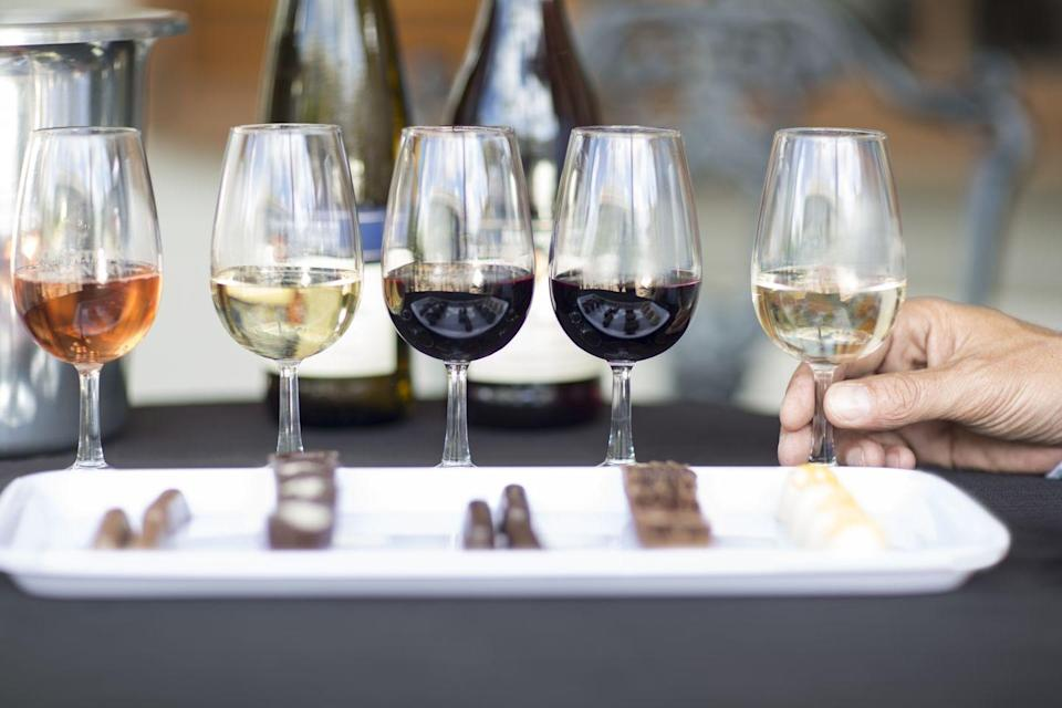 <p>Pick a theme (Italian reds? New world wines? Pinot noirs?), and snag a few bottles to compare and contrast. Bonus points for a fancy cheese plate! </p>