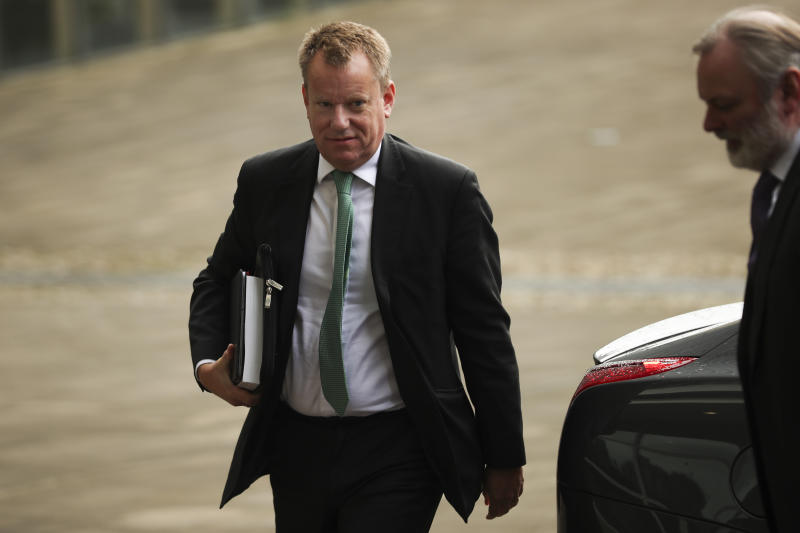 United Kingdom's Brexit advisor David Frost, left, and British Ambassador to the EU Tim Barrow arrive at EU headquarters for a technical meeting on Brexit in Brussels, Friday, Oct. 4, 2019. (AP Photo/Francisco Seco)