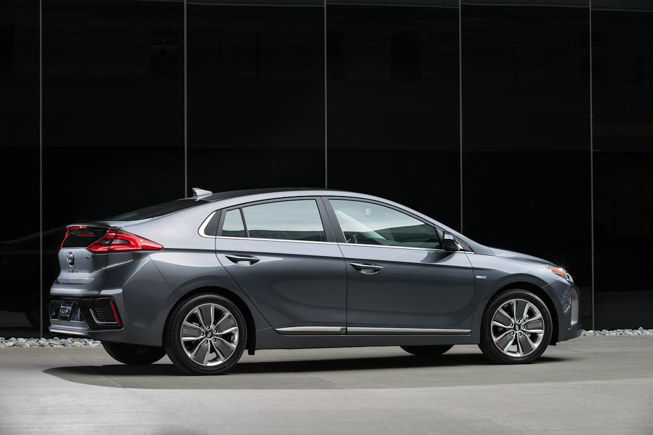 <p> This photo provided by Hyundai Motor America shows the 2017 Ioniq Hybrid. The 2017 Ioniq Hybrid is Hyundai's fuel-efficient challenger to the Toyota Prius, America's best-selling gasoline-electric hybrid. The five-seat Ioniq Hybrid beats all other hybrids in federal government fuel economy ratings, with 57 miles per gallon in city driving and 59 mpg on highways for the base Ioniq Blue model, compared with 58/53 mpg for the 2017 Prius Eco. (Courtesy of Hyundai Motor America via AP) </p>