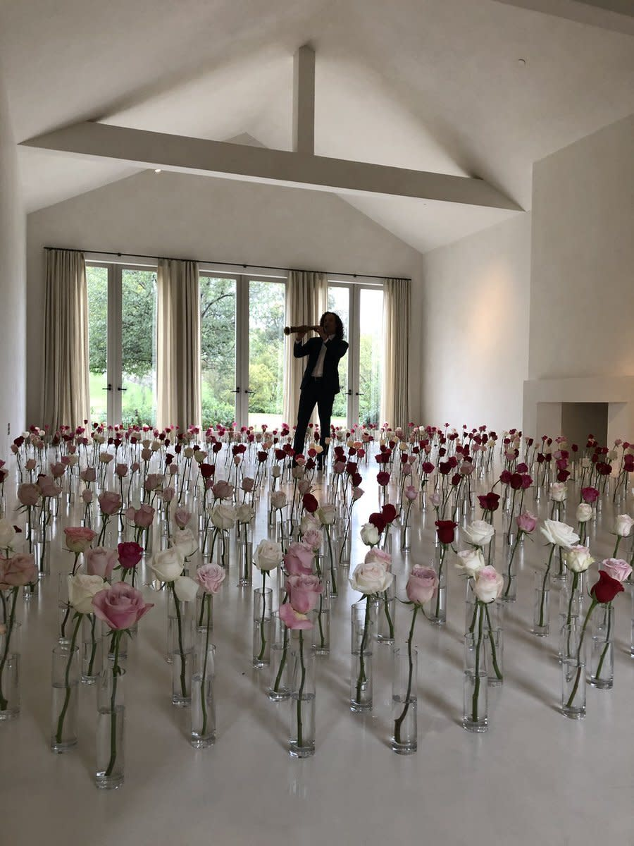 """For Valentine's Day, Kanye gifted Kim the sweet surprise of <a href=""""https://people.com/music/kenny-g-explains-valentines-day-surprise-kim-kardashian/"""" rel=""""nofollow noopener"""" target=""""_blank"""" data-ylk=""""slk:Kenny G playing tunes in her living room"""" class=""""link rapid-noclick-resp"""">Kenny G playing tunes in her living room</a> while standing in the middle of a field of roses. """"NO BIG DEAL KENNY G IN MY LIVING ROOM!!! Happy Valentines Day,"""" Kardashian West tweeted alongside one video of the experience."""