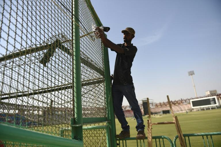 A Pakistani technician installs a security camera at Karachi's National Cricket Stadium
