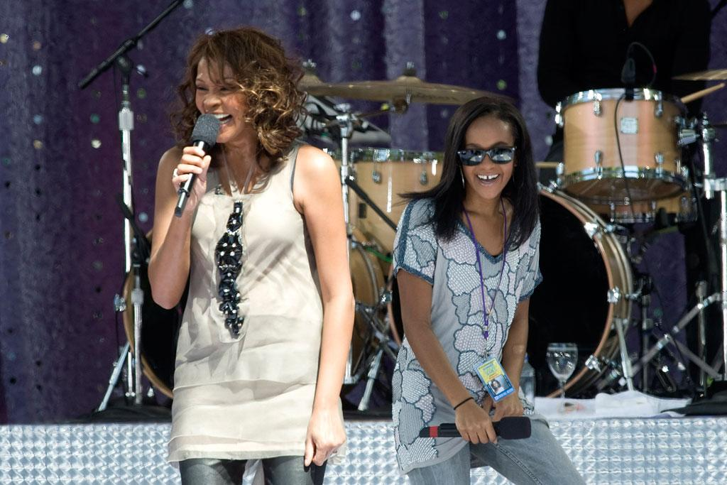 """At one point, Whitney's daughter, Bobbi Kristina, joined Mom on stage. Houston's new album, """"I Look to You,"""" hit stores this week. Lee/Everett Collection - September 1, 2009"""