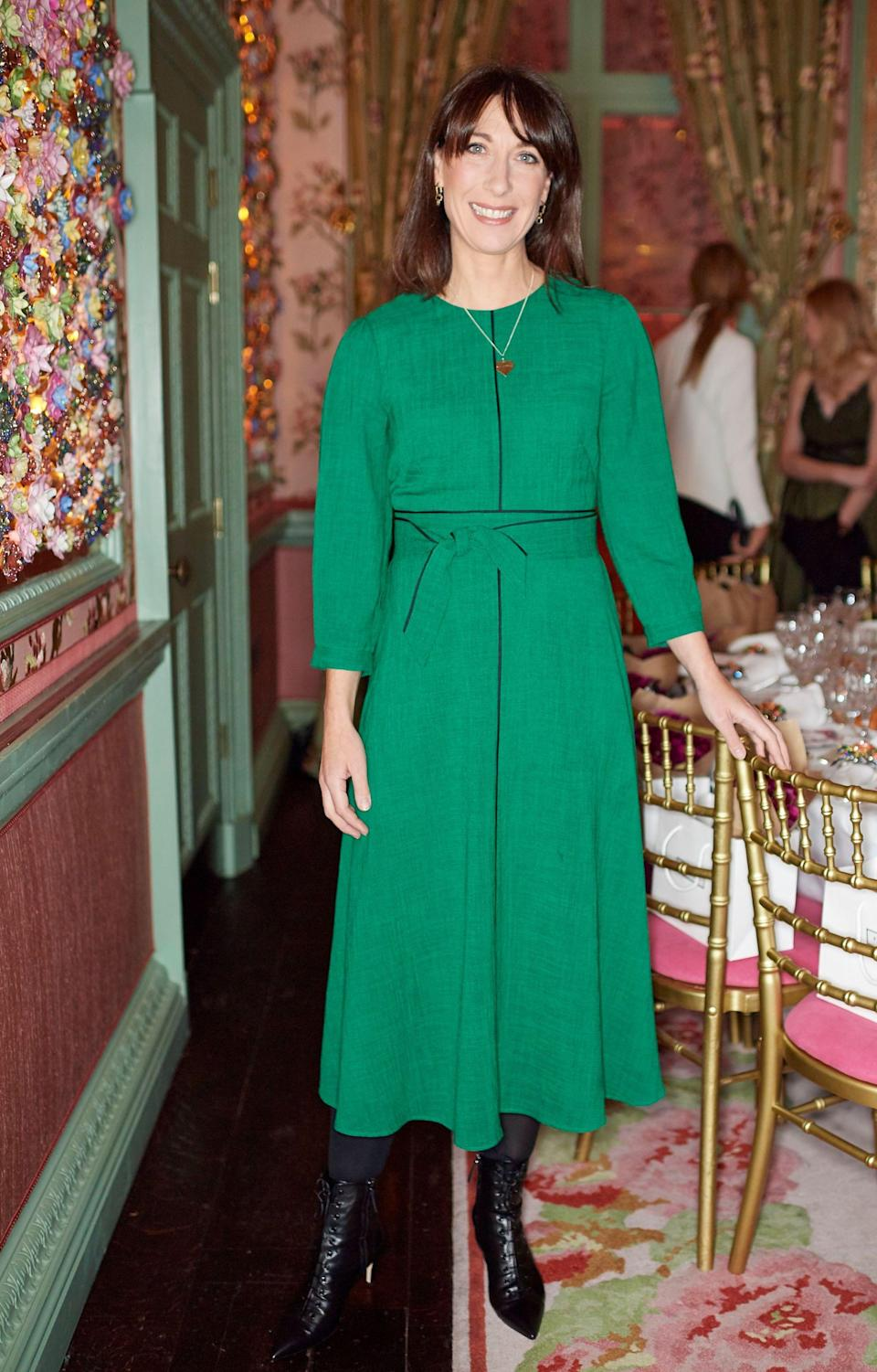 <p>On November 21, Samantha Cameron donned a green midi dress and winter-ready boots for a Monica Vinader Thanksgiving Dinner in London. <em>[Photo: Rex]</em> </p>