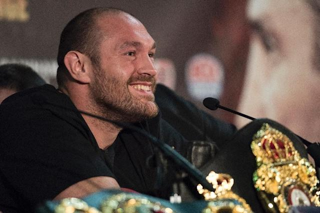 "British heavyweight boxer Tyson Fury reacts during a press conference to publicise his forthcoming world heavyweight title fight against Ukranian heavyweight Wladimir Klitschko, at the Manchester Arena in Manchester, north-west England on April 27, 2016.Wladimir Klitschko has insisted he was ""glad"" to have lost his world heavyweight titles to Tyson Fury in December 2015, ahead of a re-match with the British boxer on July 9, 2016. With Klitschko's loss to Fury, the belts are now spread far and wide, with Fury holding the WBA and WBO titles, fellow Briton Anthony Joshua the IBF champion, and Deontay Wilder of the United States, the World Boxing Council's heavyweight title. (AFP Photo/OLI SCARFF)"