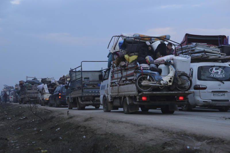 Truckloads of civilians flee a Syrian military offensive in Idlib province on the main road near Hazano, Syria, Tuesday, Dec. 24, 2019. Syrian forces launched a wide ground offensive last week into the northwestern province of Idlib, which is dominated by al-Qaida-linked militants. The United Nations estimates that some 60,000 people have fled from the area, heading south, after the bombings intensified earlier this month. (AP Photo/Ghaith al-Sayed)