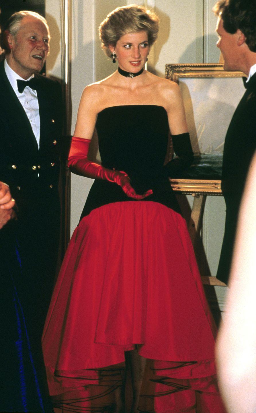 <p>In a strapless flamenco dress by Murray Arbeid and gloves and a black choker while attending the America's Cup Ball at a hotel in London. </p>