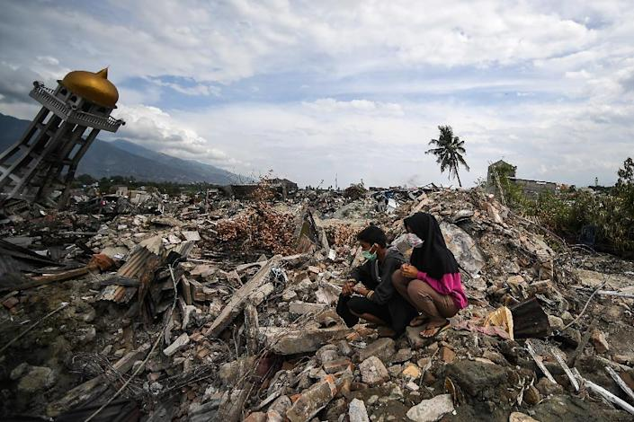 More than a thousand people are still feared missing in the seaside Indonesian city of Palu (AFP Photo/MOHD RASFAN)