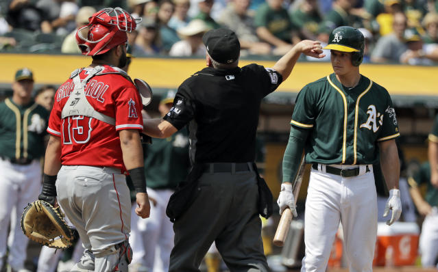 A's rookie Matt Chapman is tossed from the game by home plate umpire Mike Everitt after Chapman argued with Los Angeles Angels catcher Juan Graterol. (AP)