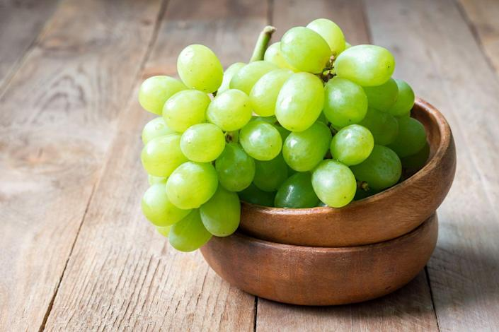 """<p>Grapes are a great two-for-one punch in battling constipation. """"Grapes have a lot of fiber, but they also have a lot of water,"""" Cording says. """"That combination is really helpful, given that you need water to help pass fiber through your digestive system.""""</p>"""