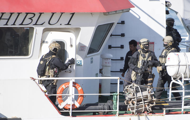 Armed forces stand onboard the Turkish oil tanker El Hiblu 1, which was hijacked by migrants, in Valletta, Malta, Thursday March 28, 2019. A Maltese special operations team boarded a tanker Thursday that had been hijacked by migrants rescued at sea and recaptured control of it before escorting it to a Maltese port. Italy's hard-line interior minister slammed the migrants as pirates but aid groups rejected that label, saying the European Union's policy of sending migrants back to lawless Libya was to blame. (AP Photo/Rene' Rossignaud)