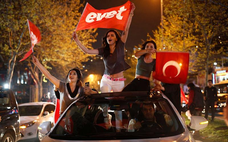 Yes supporters celebrate after narrowly winning Sunday's referendum - AP
