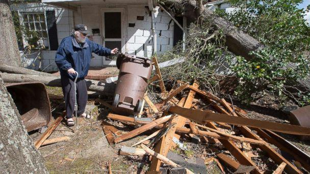 PHOTO: David Oldham, on Oak Grove Avenue, stands amid wreckage the day after a tornado sent a tree crashing into his house, April 16, 2018, in Greensboro, N.C. (Joseph Rodriguez/News & Record via AP)