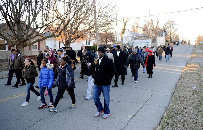 People march down Washington Street towards Greater Norris Chapel Baptist Church during the Henderson County Black History Committee's Celebration of Dr. Martin Luther King, Jr's birthday in Henderson, Ky. Sunday Jan. 19, 2014. (AP Photo/The Gleaner, Darrin Phegley)