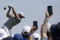 Fans watch as Dustin Johnson plays his shot from the second tee during the first round of the U.S. Open Golf Championship, Thursday, June 17, 2021, at Torrey Pines Golf Course in San Diego. (AP Photo/Gregory Bull)
