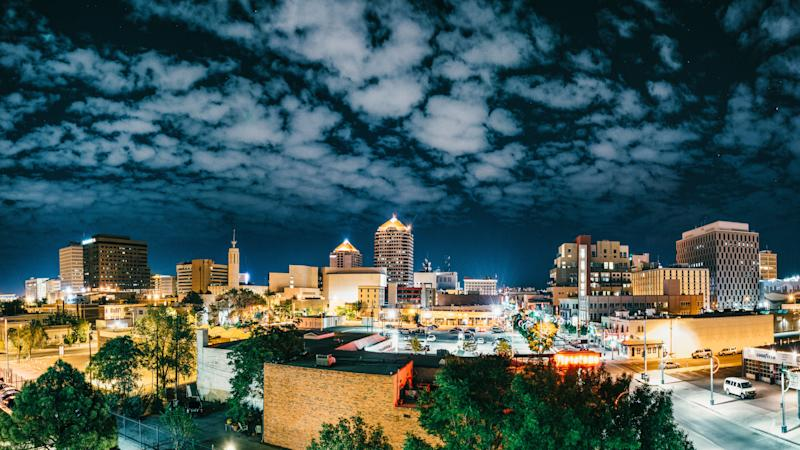 Downtown Albuquerque at night. The most recent federal monitor's report found APD to be 47 percent in operational compliance with the consent decree. For a judge to consider lifting the decree, it must be 95 percent for two years. (ferrantraite via Getty Images)