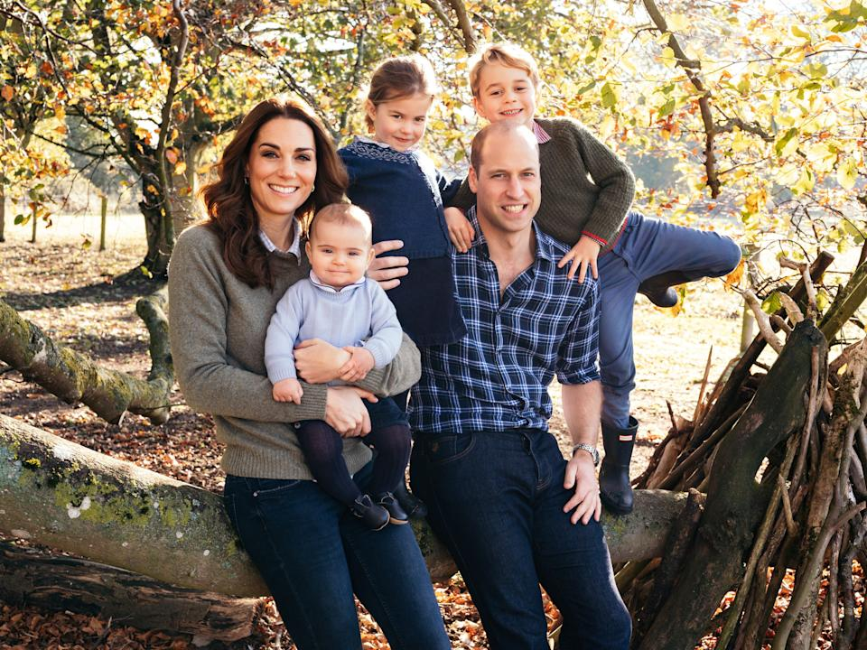 Princess Charlotte, Prince Louis, Prince George, Prince William and Kate Middleton sitting on a tree