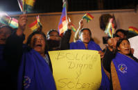 """Supporters of Bolivia's President Evo Morales shout slogans and wave Bolivian flags with a sign that reads in Spanish """"Bolivia dignified and sovereign"""" as they protest outside France's embassy in La Paz, Bolivia, Tuesday, July 2, 2013. Bolivia's Foreign Minister David Choquehuanca says the plane bringing President Evo Morales home from Russia was rerouted to Austria after France and Portugal refused to let it to cross their airspace because of suspicions that NSA leaker Edward Snowden was on board. Officials in both Austria and Bolivia said that Snowden was not on the plane. (AP Photo/Juan Karita)"""