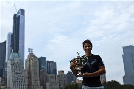 Nadal of Spain poses with his trophy after winning the men's singles final match against Djokovic of Serbia at the U.S. Open tennis tournament in New York's Central Park