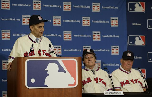 Joe Torre, left, speaks at a news conference with Tony La Russa, center, and Bobby Cox after it was announced the retired managers were unanimously elected to the baseball Hall of Fame during the MLB winter meetings in Lake Buena Vista, Fla., Monday, Dec. 9, 2013. (AP Photo/John Raoux)